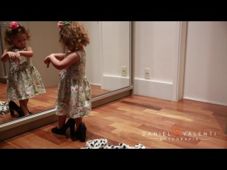 Little girl dances in front of the mirror