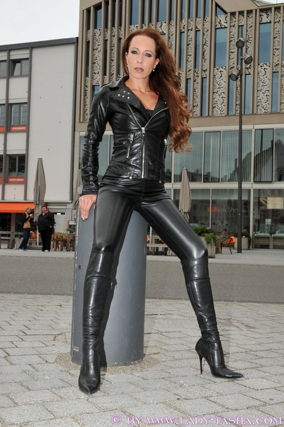 Jynx Maze In Latex Outfit And Boots Posing Front 1