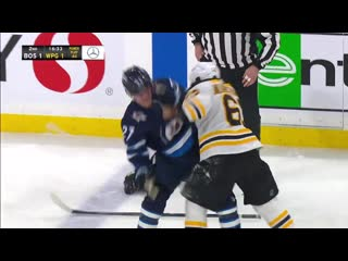 Brad marchand and nikolaj ehlers drop the gloves after big hit